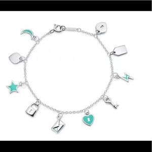 Brand new Tiffany charms love note dangle bracelet